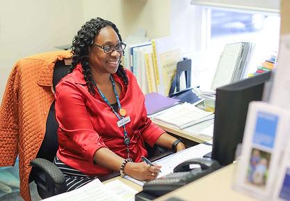 primacare staff member working at desk