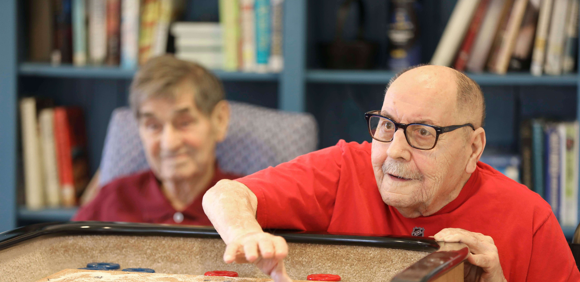 henley house senior residents playing shuffleboard