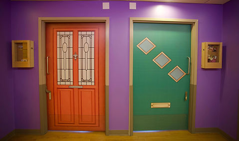primacare butterfly model of care colorful resident doors