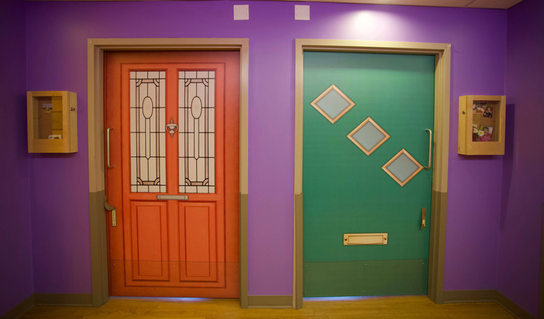 henley house butterfly model of care colorful resident doors