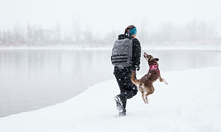 Jaala Shaw and dog carmen in the snow