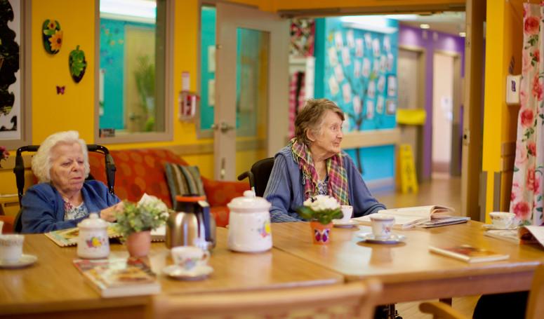 henley place senior residents having tea