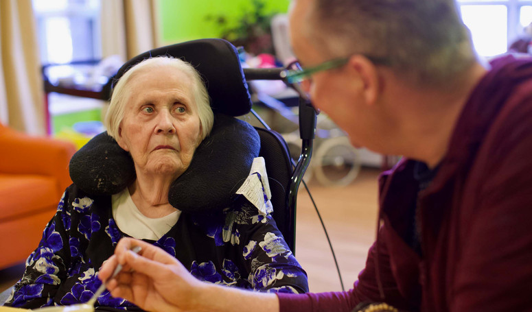henley place senior resident having lunch with family