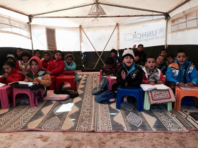 syrian refugee students in a tent