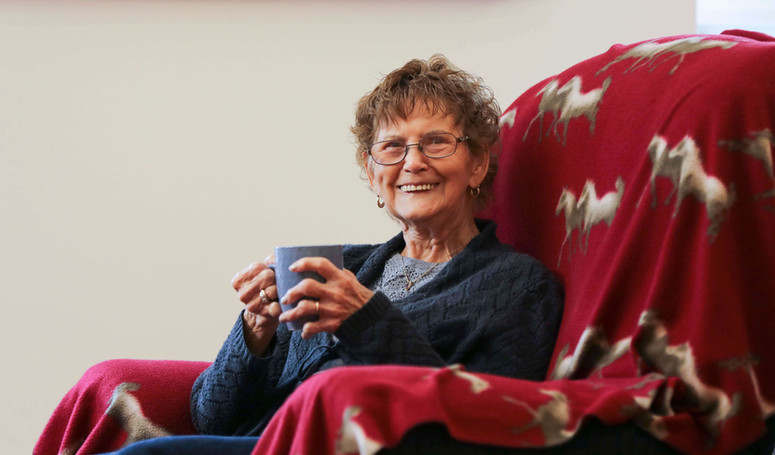 henley house resident sitting in chair