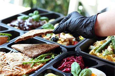 hands packaing food into containers
