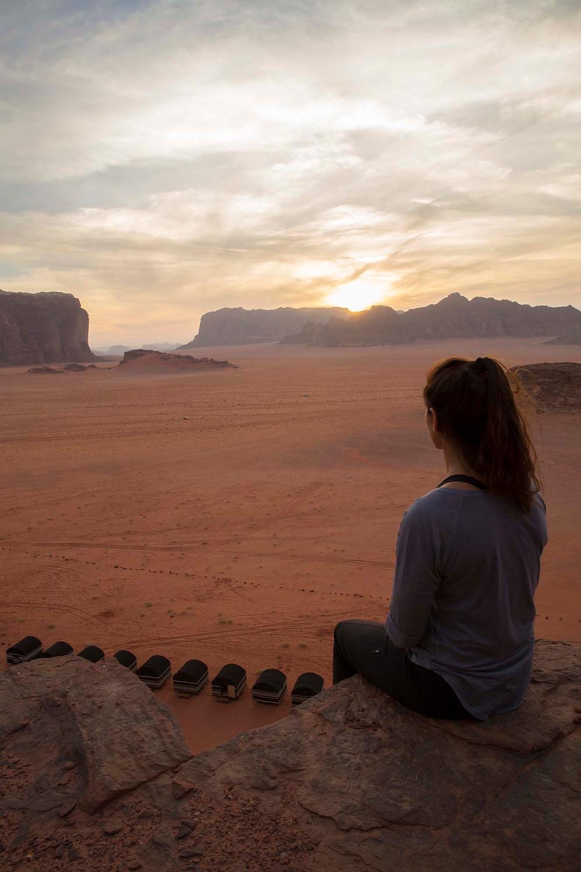jaala sitting on wall in Jordan Wadi Rum Sunset
