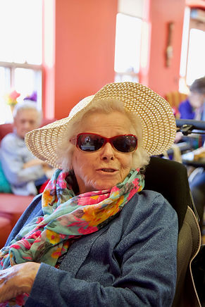 primacare senior resident wearing hat and sunglasses