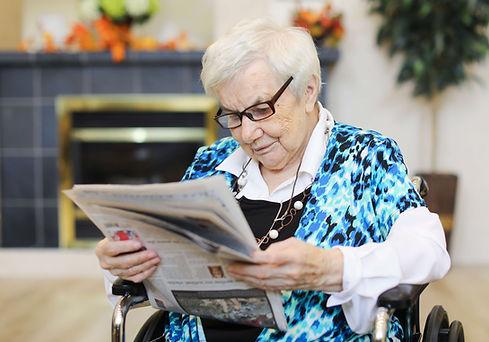burton manor resident readinfg the newspaper