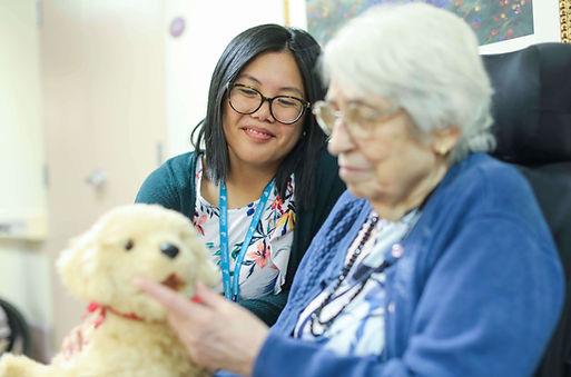 burton manor resident sitting with nurse