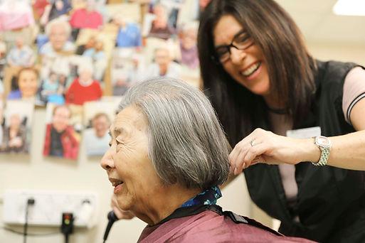 henley house resident having her hair cut