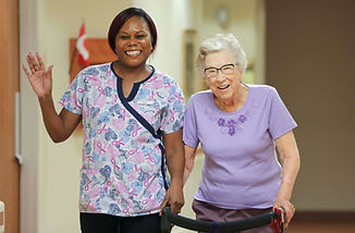 primacare staff member and senior resident walking