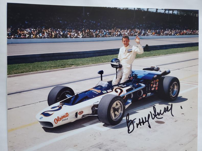 Bobby Unser and 1971 Olsonite Eagele.jpg