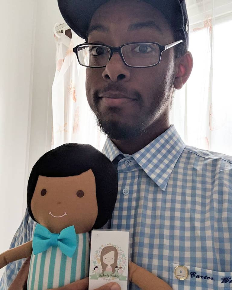 Ryan Carter and his companion doll from Charlotte (The Ryan Carter Foundation)