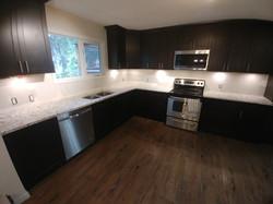 Dark kitchen with light counter