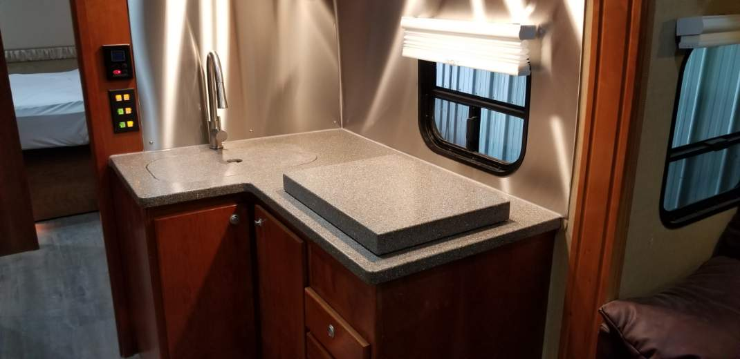 Sylvan Lake RV Kitchen with covers