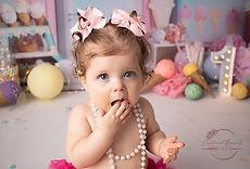 baby eating cake in cake smash shoot. icecream theme