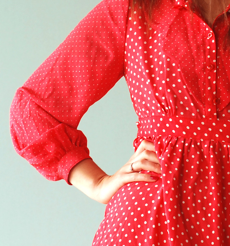 woman's torso in a red polka dot dress