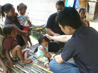 Praying for the little ones at a village in Gilimanuk, Bali