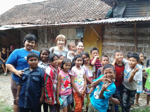 Children beaming for a group photo at Surabaya