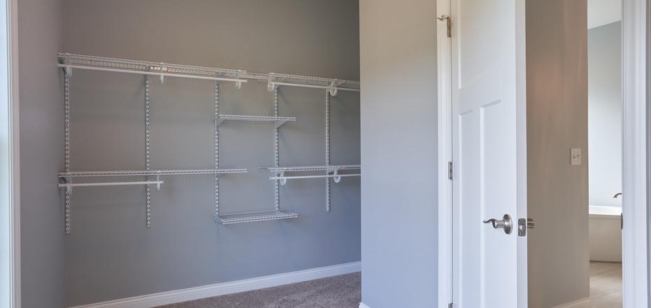New Home-Inside Walk-In Bedroom Closet