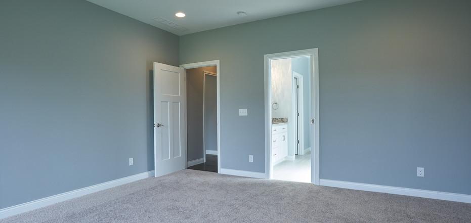 New Home-Empty Bedroom Leading Into Bathroom