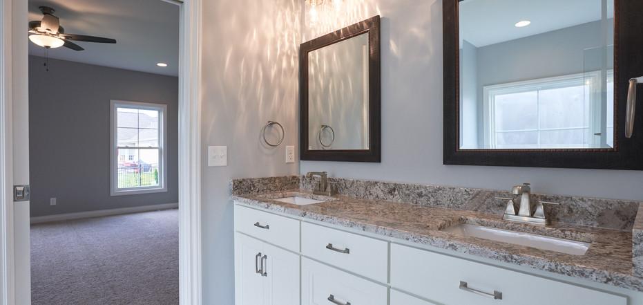 New Home-Bathroom Leading Into Bedroom