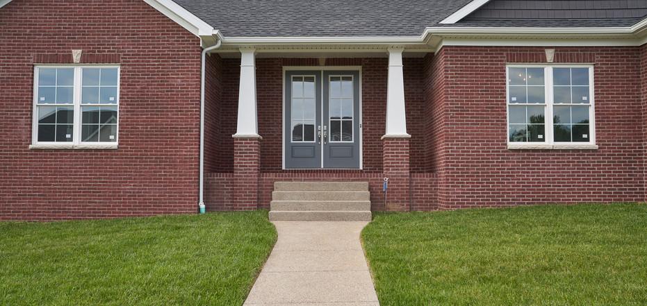 New Home-Exterior Walkway Leading to Double Front Door