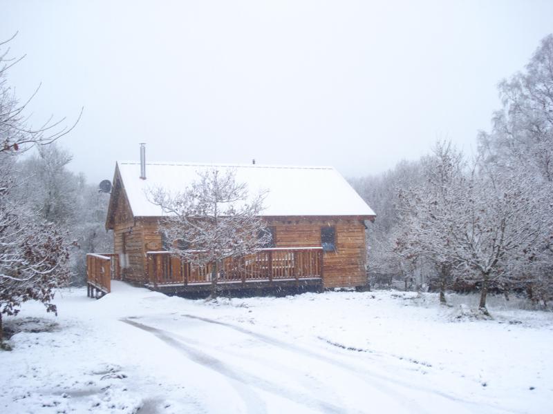 Oak Log cabin in the snow