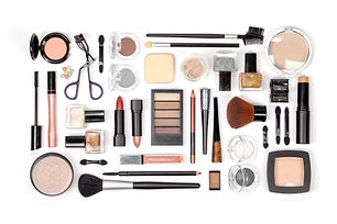 makeup cosmetics and brushes on white ba