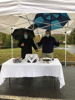 Curbside communion in rain 1.JPG