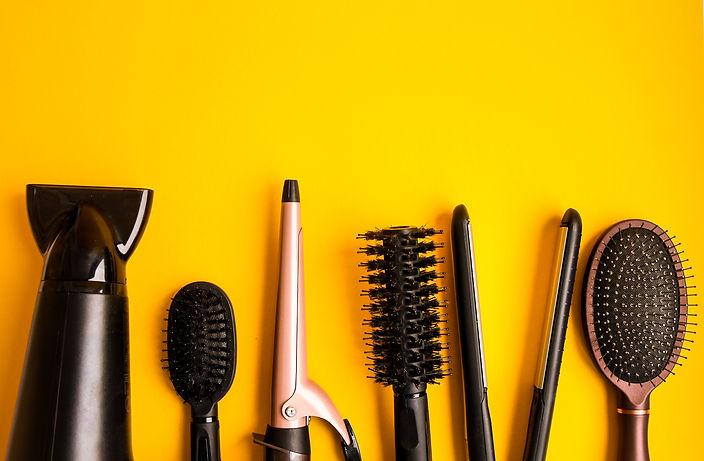 Professional hair dresser tools on yello