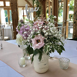 Mason jar of pasel flowers. chseshire wedding, floral centrepiece