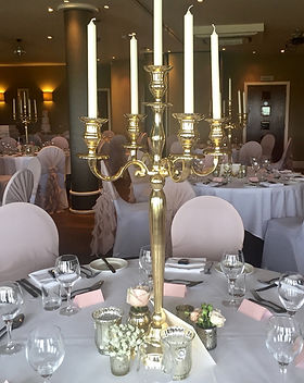 Tall gold candelabras