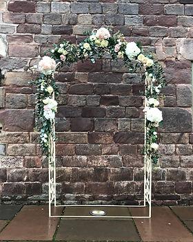 Ivory wedding arch