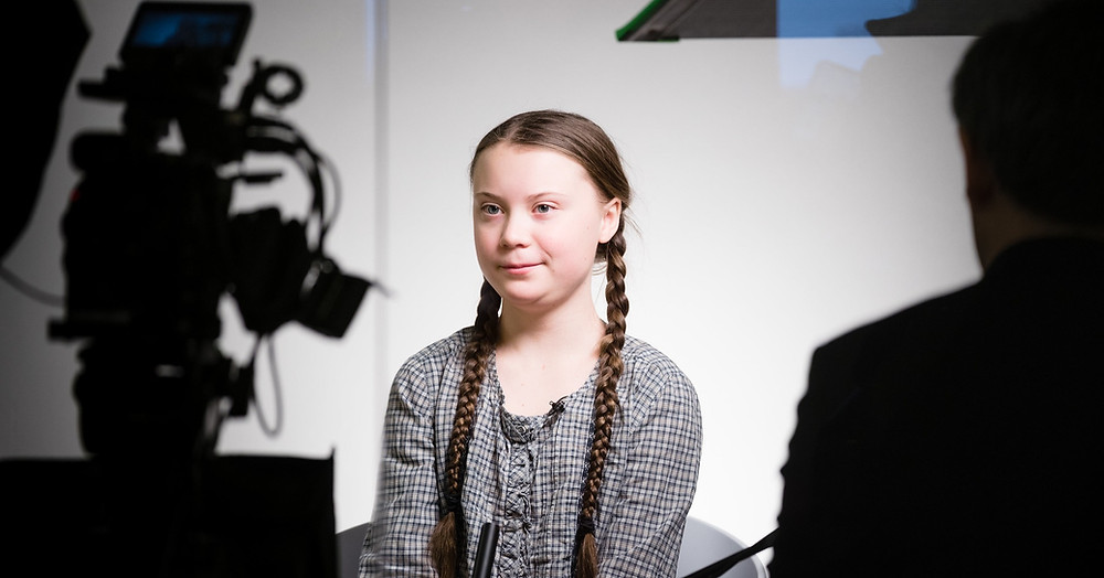 young girl in front of camera
