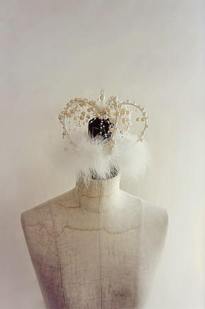 Pearl-drop crown headpiece.