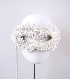 White flower mask with hundle