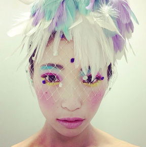 Pastel colored feather headpiece.