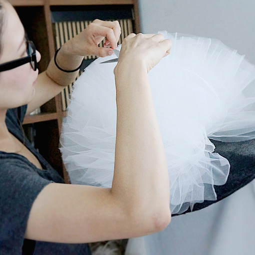 Making hat: trim tulle layers.