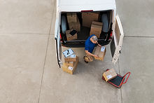 courier-delivering-parcel-PQZHBGE.jpg