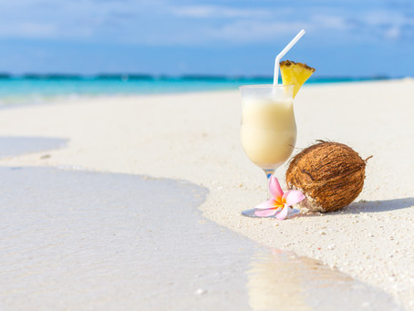 Rum and Coconut Cocktails On The Beach