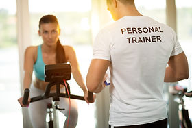 Personal trainer at the gym with client