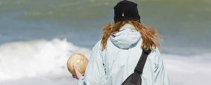 Woman carrying globe