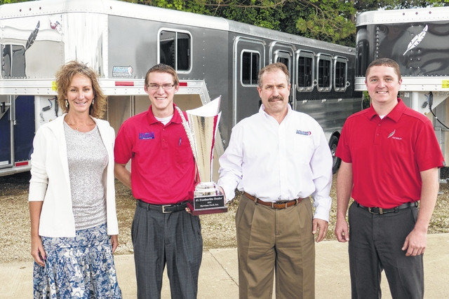 Courtesy photo Pictured are Angie Hook (northeast territorial sales manager), Steven Garner (Harrison Ford trailer manager), Rodney Harrison (dealer), and Justin Queensland (Featherlite national sales manager).