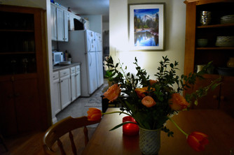Close-up of dining room table and flowers