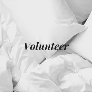 Pillows on bed with word: Volunteer