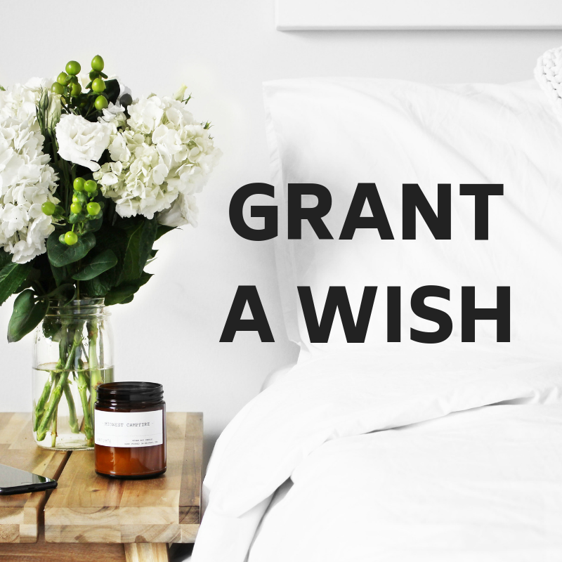 Photo of bed and side table with text: Grant a Wish
