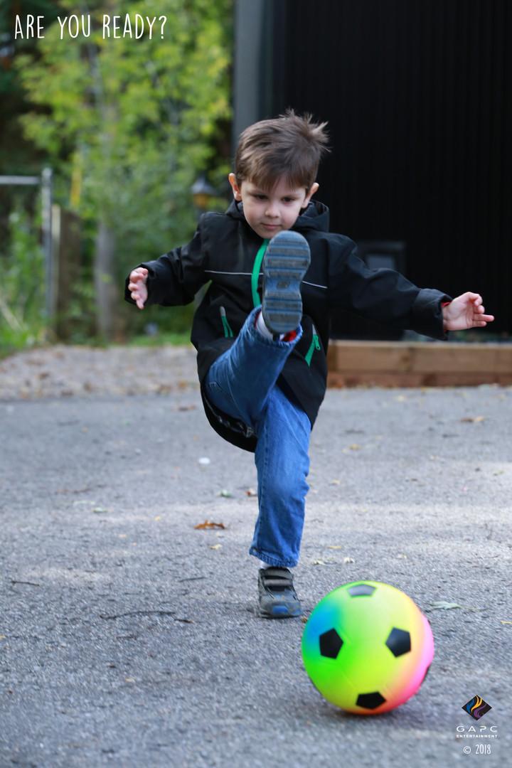Eric_Playing Outside_Kicking Ball copy.j