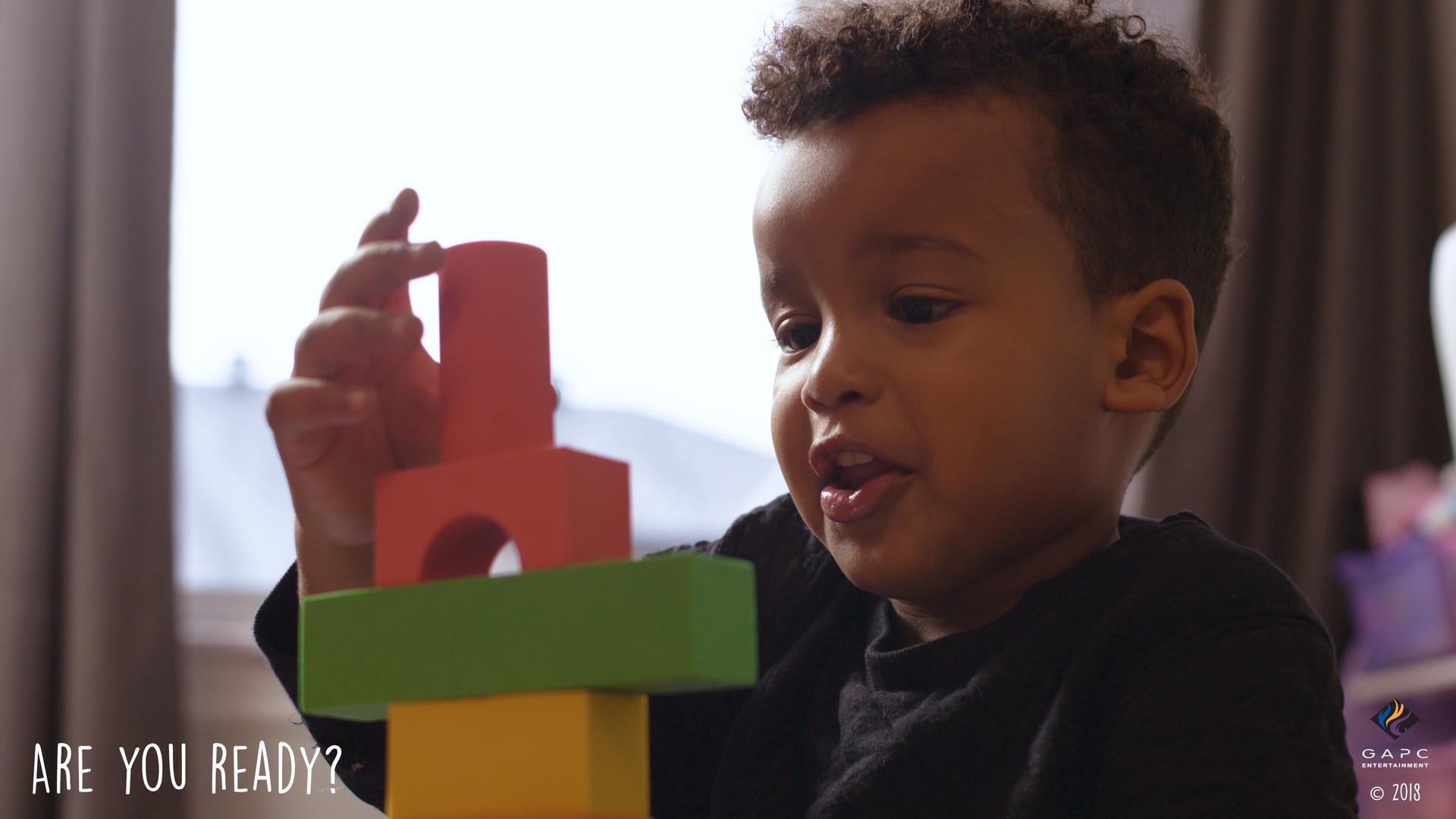 Malik_Playing with Blocks_Last Piece.jpg